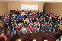 Thursday March 2, 2006.  Anchorage, Alaska.  The field of 83 Iditarod mushers pose for a group photo during a mandatory musher meeting prior to the race.