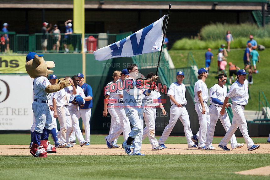 South Bend Cubs Alberto Mineo (47) waves the W flag, from mascot Stu, after a walk off base hit during the first game of a doubleheader against the Peoria Chiefs on July 25, 2016 at Four Winds Field in South Bend, Indiana.  South Bend defeated Peoria 9-8.  (Mike Janes/Four Seam Images)