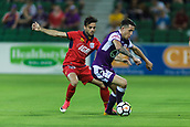 4th November 2017, nib Stadium, Perth, Australia; A-League football, Perth Glory versus Adelaide United; Scott Neville of Perth Glory turns away with the ball under pressure from Nikola Mileusnic of Adelaide United