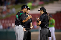 Dayton Dragons manager Luis Bolivar (14) argues a call with umpires A.J. Choc and Emma Charlesworth-Seiler during a Midwest League game against the Kane County Cougars on July 20, 2019 at Northwestern Medicine Field in Geneva, Illinois.  Dayton defeated Kane County 1-0.  (Mike Janes/Four Seam Images)