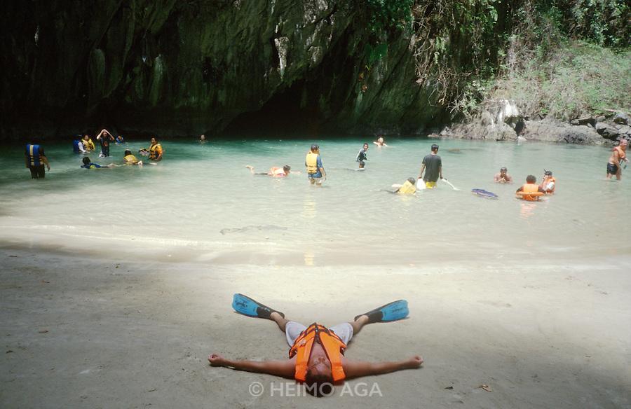 "Thai tourist group during an excursion to the ""Blue Pool"" through a tidal grotto on Ko Muk."