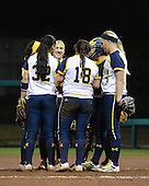 Michigan Wolverines Softball team huddle during a game against the University of South Florida Bulls on February 8, 2014 at the USF Softball Stadium in Tampa, Florida.  Michigan defeated USF 3-2.  (Copyright Mike Janes Photography)