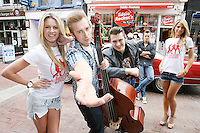 NO REPRO FEE. 29/7/2010. Everybody's favourite German Rock 'n' Roll band, THE BASEBALLS&nbsp;are pictured on Grafton St Dublin for their first Irish visit to promote their massive hit album 'Strike'. The trio of Sam, Digger and Basti  are pictured with models Jenny Lee Masterson and Vogue Williams. The band represent a new evolution of the musical heritage of Elvis, Jerry Lee Lewis, Buddy Holly &amp; Co. - &quot;Voc'n'Roll&quot; was born and The Baseballs at the same time!<br /> The band&nbsp;put a truly unique twist on modern day anthems such as Rihanna's 'Umbrella', Beyonce's 'Crazy in Love', and new single, their&nbsp;take on Katy Perry's 'Hot n Cold'.To quote the band, &quot;We take good songs and lead them to their true calling.&quot;Already massive all over Europe, their debut&nbsp;album has sold over 600,000 albums worldwide so far and debuted at No.4 in the UK.T The Baseballs&nbsp;support Jeff Beck on his UK tour in October -&nbsp;including a date at the Royal Albert Hall - and are&nbsp;due to return to Ireland&nbsp;later this year for their debut Irish show.Official site: www.thebaseballs.com Photos: www.thebaseballs.com/photos Videos: www.thebaseballs.com/videos For more info please contact: Ciaran Savage, Warner Music Ireland - Tel: 086 8747 704 John McCallion, Warner Music Ireland - Tel: 087 7679 554. Picture James Horan/Collins Photos