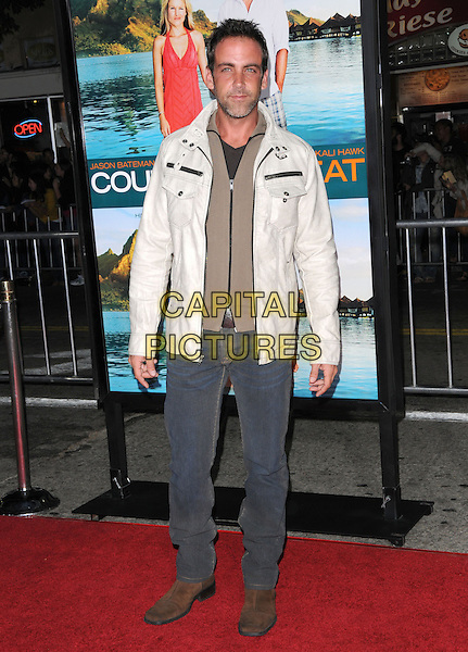 "CARLOS PONCE.The Universal Pictures Premiere of ""Couples Retreat"" held at The Village Theatre in Westwood, California, USA. October 5th, 2009 .full length white cream brown beige jacket top jeans denim.CAP/DVS.©Debbie VanStory/Capital Pictures."
