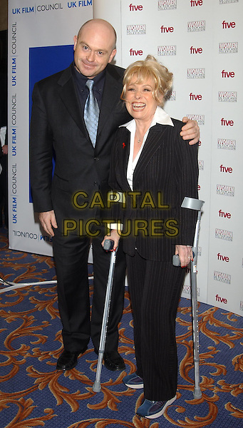 ROSS KEMP & BARBARA WINDSOR.Women in Film and Television Awards.Hilton Hotel.05 December 2003.full length, full-length, crutches, broken, injury, foot, leg, ankle ?.©Capital Pictures.sales@capitalpictures.com.www.capitalpictures.com.©Capital Pictures
