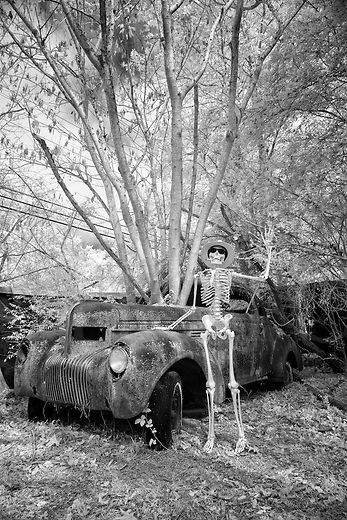 During a pit stop on the Highway to Hell bound for the Other Side and the big Halloween party, Jake waves to passersby while standing beside his 1934 Chevy&hellip;it&rsquo;s a good place to enjoy the scenery and fresh air in rural roadside America while resting your bones. Traveling light yet still in style, he packs only his fedora and sunglasses along with some cigars. Better get that headlight fixed at the next gas station!<br />