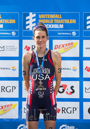 24 AUG 2013 - STOCKHOLM, SWE - Gwen Jorgensen (USA) of the USA  celebrates winning the ITU 2013 World Triathlon Series round in Gamla Stan, Stockholm, Sweden (PHOTO COPYRIGHT © 2013 NIGEL FARROW, ALL RIGHTS RESERVED)