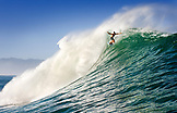 USA, Hawaii, man surfs a large wave on an outer reef, the North Shore of Oahu