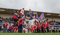 Mark Bright (Captain) of London Scottish leads the team out during the Greene King IPA Championship match between London Scottish Football Club and Jersey at Richmond Athletic Ground, Richmond, United Kingdom on 7 November 2015. Photo by Andy Rowland.
