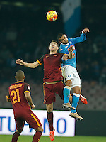 Napoli's Faouzi Ghoulam  n AS Roma's Edin Dzeko  during the  italian serie a soccer match,between SSC Napoli and AS Roma       at  the San  Paolo   stadium in Naples  Italy ,December 13, 2015
