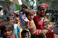 Myanmar Rohingya people beg outside a mosque after the Friday prayers in Sittwe May 18, 2012. REUTERS/Damir Sagolj (MYANMAR)