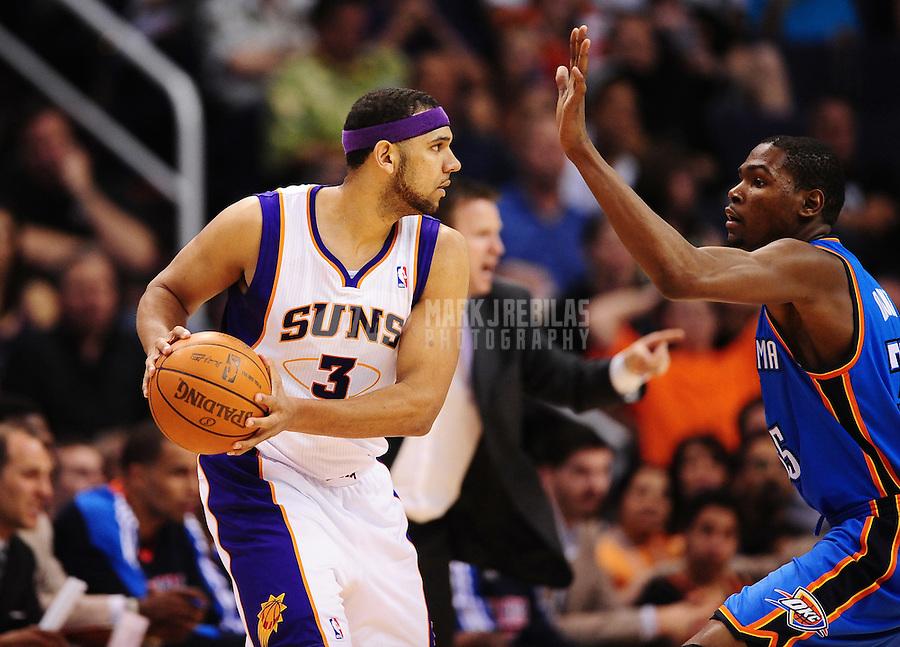 Mar. 30, 2011; Phoenix, AZ, USA; Phoenix Suns forward (3) Jared Dudley against Oklahoma City Thunder forward Kevin Durant at the US Airways Center. Mandatory Credit: Mark J. Rebilas-.