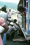 Repairing a tyre on a bus, Images of the capital,Port au Prince, Haiti 1975
