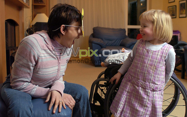 Pix by BEN DUFFY/SWpix.com......Sport Feature - Tanni Grey-Thopmson....11/01/05..Picture Copyright >> Simon Wilkinson >> 07811267706..Paralympic athelete, Tanni Grey-Thompson pictured at home in Redcarwith daughter Carys