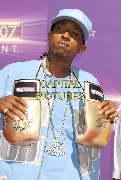 UNK .2007 BET Awards held the at Shrine Auditorium, Los Angeles, California, USA..June 26th, 2007.half length gold boxing gloves stomp the yard award sunglasses shades baseball cap hat blue necklace bling big oomp records .CAP/ADM/RE.©Russ Elliot/AdMedia/Capital Pictures