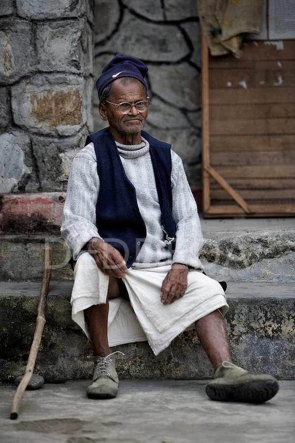 """An elderly man with his stick cane at an """"Aged Shelter"""" in Pokhara, Nepal."""