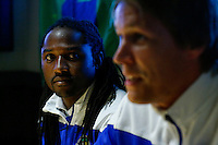 """Zimbabwean soccer player Luckymore """"Lucky"""" Mkosana (L) looks at  Norway soccer player Mads Stokkelien while they attend a media event of their New York Cosmos team in Manhattan, New York 24.03.2015. Eduardo Munoz Alvarez/VIEWpress."""