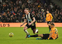 Newcastle United's Sean Longstaff is tackled by Wolverhampton Wanderers' Romain Saiss <br /> Photographer Lee Parker/CameraSport<br /> <br /> The Premier League - Wolverhampton Wanderers v Newcastle United - Saturday 11th January 2020 - Molineux - Wolverhampton<br /> <br /> World Copyright © 2020 CameraSport. All rights reserved. 43 Linden Ave. Countesthorpe. Leicester. England. LE8 5PG - Tel: +44 (0) 116 277 4147 - admin@camerasport.com - www.camerasport.com