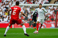 Jesse Lingard (Manchester United) of England (right) takes on Steve Borg of Malta (left) during the FIFA World Cup qualifying match between England and Malta at Wembley Stadium, London, England on 8 October 2016. Photo by David Horn / PRiME Media Images.