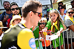 Hopeful fans at sign on before the start of Stage 14 of the 2018 Tour de France running 188km from Saint-Paul-Trois-Chateaux to Mende, France. 21st July 2018. <br /> Picture: ASO/Alex Broadway | Cyclefile<br /> All photos usage must carry mandatory copyright credit (&copy; Cyclefile | ASO/Alex Broadway)