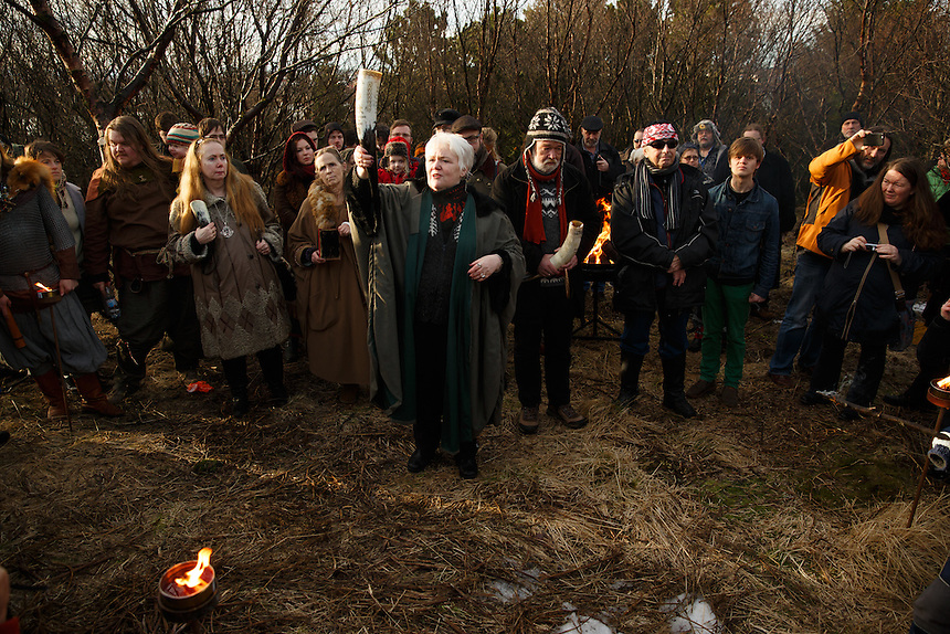 Jóhanna Harðardóttir brings offering to the deities at the hight of the solar eclipse in Reykjavik Iceland.