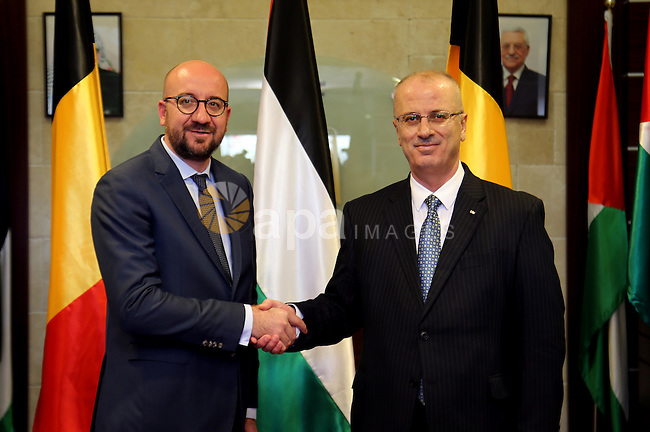 Palestinian Prime Minister Rami Hamdallah shakes hands with Belgian Prime Minister Charles Michel in the West Bank city of Ramallah February 7, 2017. Photo by Prime Minister Office