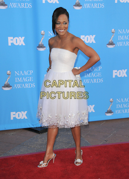 ROBIN GIVENS .Attends The 39th NAACP Image Awards held at The Shrine Auditorium in Los Angeles, California, USA..February 14th, 2008        .full length white sheer strapless dress hand on hip silver shoes .CAP/DVS.©Debbie VanStory/Capital Pictures.