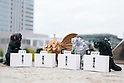 Capsule toy models of characters from the Godzilla movies bow in deep apology during a press conference on September 14, 2016, Tokyo, Japan. Japanese toy maker Bandai created a series of four monsters called the ''Godzilla Toho Monsters Press Conference'' marketed as vending machine capsule toys. The model monsters are bowing in front of a press stand expressing their formal apologies for acts of destruction in the country. They are on sale for 300 Yen (approx USD 2.92) each. (Photo by Rodrigo Reyes Marin/AFLO)