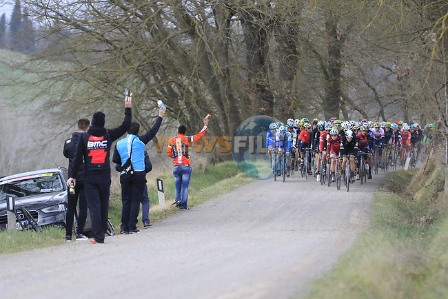Team helpers with bidons on gravel sector 4 Commune di Murlo during the 2017 Strade Bianche running 175km from Siena to Siena, Tuscany, Italy 4th March 2017.<br /> Picture: Eoin Clarke | Newsfile<br /> <br /> <br /> All photos usage must carry mandatory copyright credit (&copy; Newsfile | Eoin Clarke)