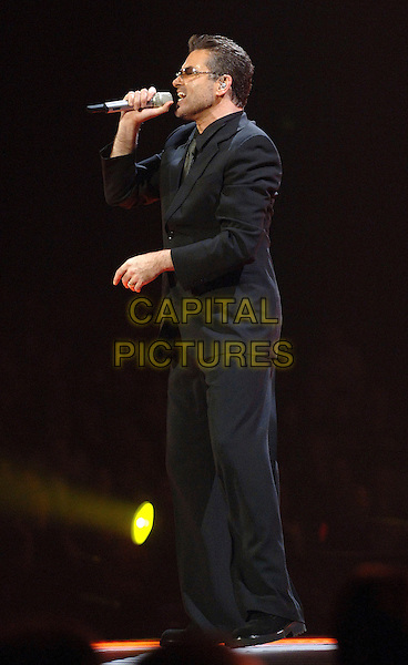 GEORGE MICHAEL.Perfoming at Earl's Court, London, UK..November 25th , 2006 .full length stage concert live gig performance music sunglasses shades black suit profile singing.CAP/BEL.©Belcher/Capital Pictures
