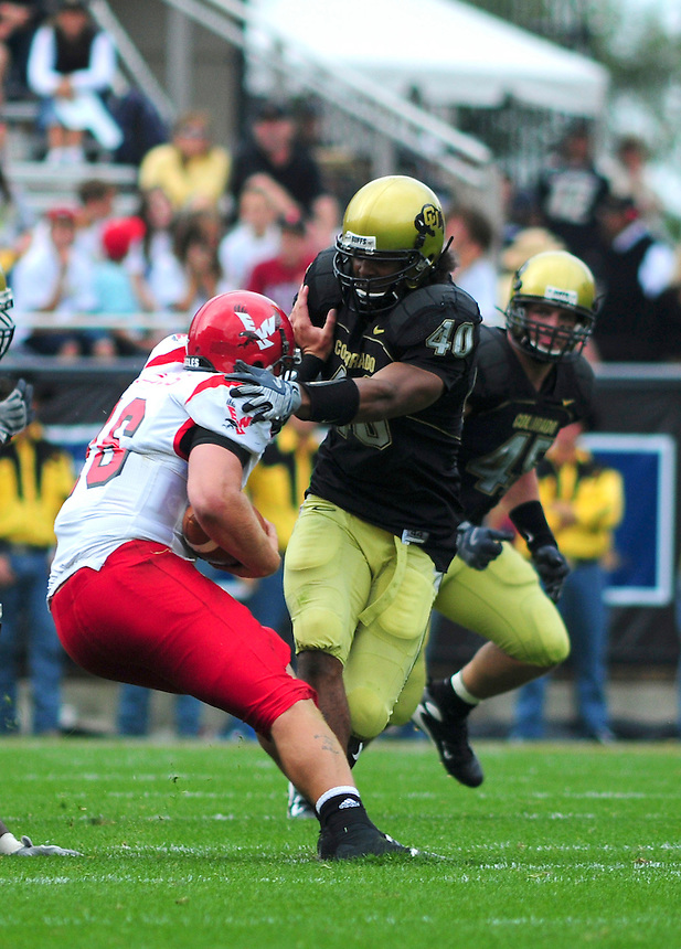 06 September 08: Colorado linebacker Brad Jones (40) about to tackle Eastern Washington quarterback Matt Nichols (16). The Colorado Buffaloes defeated the Eastern Washington Eagles 31-24 at Folsom Field in Boulder, Colorado. FOR EDITORIAL USE ONLY