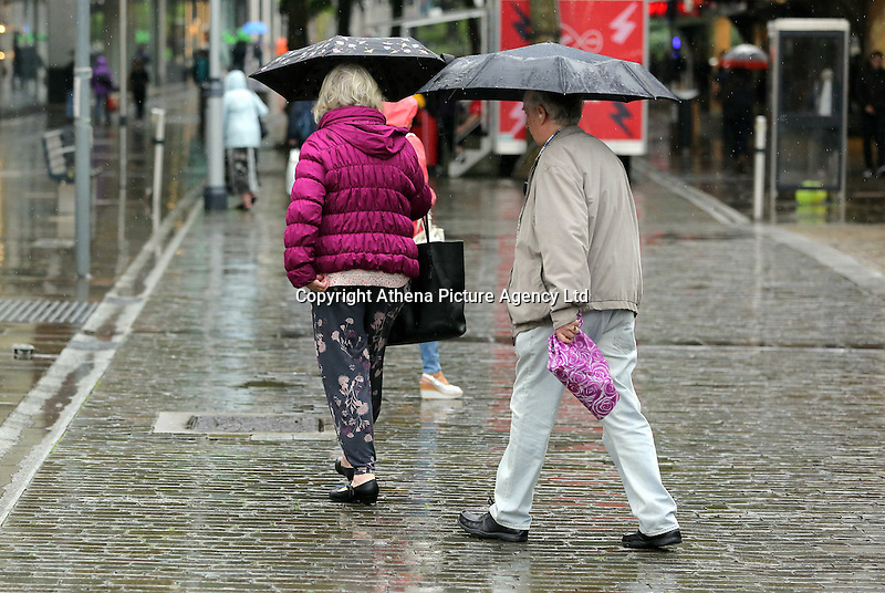 WEATHER PICTURE WALES<br />Although sunshine and high temperatures had been forecast for most of the country, shoppers Wales needed umbrellas to go about  in Oxford Street, Swansea, Wales, UK. Tuesday 13 September 2016