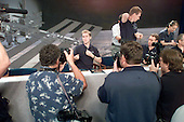 Soyuz 5 Nominated Flight Participant Lance Bass talks to reporters at the conclusion of a press conference at the Lyndon B. Johnson Space Center (JSC) in Houston, Texas on August 29, 2002. Soyuz 5 Flight Engineer Frank DeWinne (standing on stage), and Commander Sergei Zalyotin (third right on the stage) are among those pictured. DeWinne is affiliated with the European Space Agency (ESA) and Zalyotin represents Rosaviakosmos. .Credit: NASA via CNP