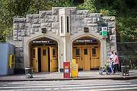 West 181st Street subway station entrance cut into the side of a hill in the hilly New York neighborhood of Washington Heights on Saturday, October 18, 2014. (© Richard B. Levine)