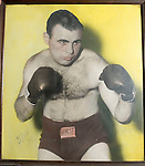 WATERBURY, CT- 02 JAN 06- 010207JT02- <br /> A poster of late Waterbury boxer Tommy Ciarlo in a hand-tinted boxing pose, which was likely done while he was in Cuba for a fight with Kid Galivan in Havana in 1951. Galivan would later become the world welterweight champion.<br /> Josalee Thrift Republican-American