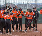 Douglases Haley Doughty is met by her teammates at home plate after hitting a homerun in the NIAA 4A Northern Regional Softball Championship at Bishop Manogue High School in Reno, Nevada on Saturday, May 12, 2018.