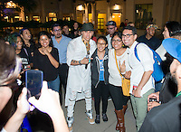 "Taboo (Jaime Gómez) of The Black Eyed Peas poses for photos with Occidental College students after performing in the AGC quad. Taboo was one of the guests of the event, ""I Am Latino in America,"" a national tour of conversations aimed at amplifying the Latino voice on critical community issues, hosted by Soledad O'Brien, October 15, 2015.<br />