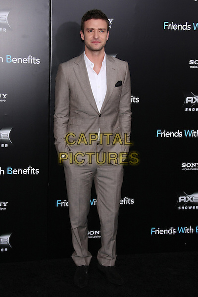 "Justin Timberlake.The New York Premiere of ""Friends With Benefits"" at the Ziegfeld Theater, New York, NY, USA..July 18th, 2011.full length white shirt beige suit hands in pockets.CAP/LNC/TOM.©LNC/Capital Pictures."