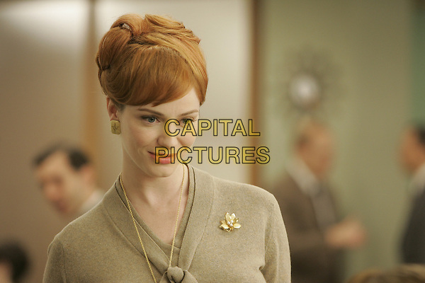 CHRISTINA HENDRICKS<br /> in Mad Men (Season 1)<br /> *Filmstill - Editorial Use Only*<br /> CAP/FB<br /> Image supplied by Capital Pictures