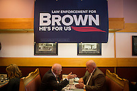 People wait for Senator Scott Brown (R-MA) to speak at a meeting of the Law Enforcement Coalition for Brown at Johnny Jack's Restaurant in Milford, Massachusetts, USA, on Thurs., Nov. 2, 2012. Senator Scott Brown is seeking re-election to the Senate.  His opponent is Elizabeth Warren, a democrat.