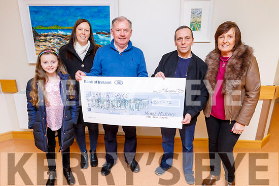 Michael Murphy from Kilflynn presents the sum of €362.92 from his Christmas house lights fundraiser  to the Kerry Hospice on Friday.<br /> L to r: Caoimhe Nammoch, Jessica Murphy Nammock, Joe Hennebry, Mike and Noreen Murphy.