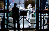 A man with a Hillary Clinton stands in front of the doors to Trump Tower in New York, New York, USA, 08 December 2016.<br /> Credit: Justin Lane / Pool via CNP
