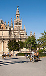 Horse and carriage rides for tourists in the historic central area near the cathedral, Seville, Spain