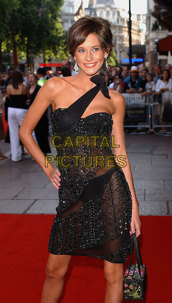 JASMINE LENNARD.The Skeleton Key Premiere.Vue Cinema, Leicester Square,.London, 20th July 2005.half length half-length black bead see-through dress underwear silver earrings handbag.www.capitalpictures.com.sales@capitalpictures.com.© Capital Pictures.