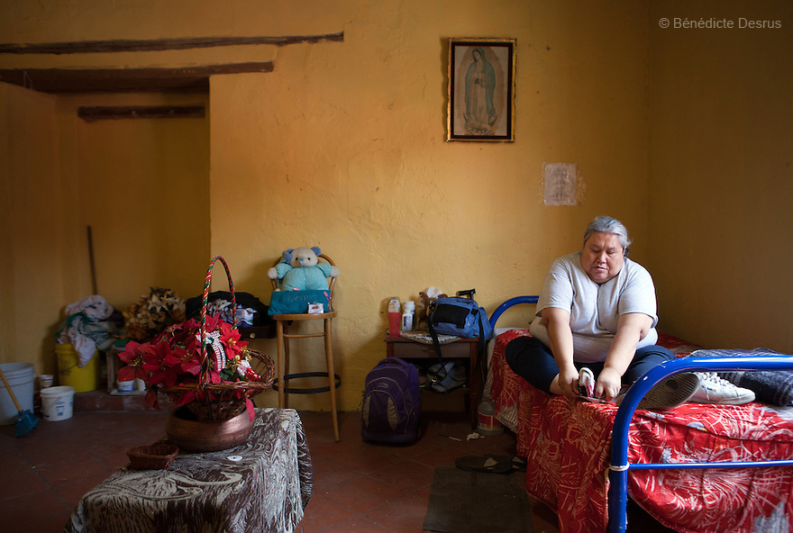 Normota, a resident of Casa Xochiquetzal, in her bedroom at the shelter in Mexico City, Mexico on May 14, 2012. Casa Xochiquetzal is a shelter for elderly sex workers in Mexico City. It gives the women refuge, food, health services, a space to learn about their human rights and courses to help them rediscover their self-confidence and deal with traumatic aspects of their lives. Casa Xochiquetzal provides a space to age with dignity for a group of vulnerable women who are often invisible to society at large. It is the only such shelter existing in Latin America. Photo by Bénédicte Desrus