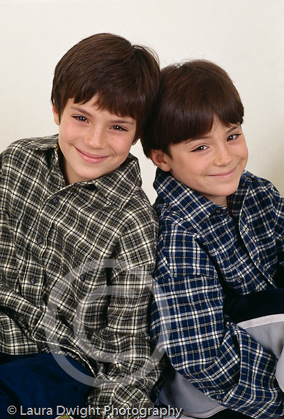 10 year old identical twin boys portrait closeup vertical