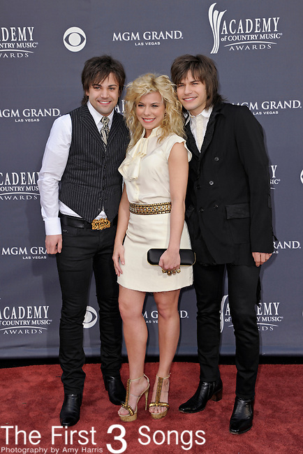 Neil Perry, Kimberly Perry and Reid Perry of The Band Perry attend the 46th Annual Academy of Country Music Awards in Las Vegas, Nevada on April 3, 2011.