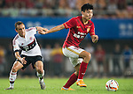 (R) Dong Xuesheng of Guangzhou Evergrande being followed by (L) Rafinha of Bayern Munich during the Bayern Munich vs Guangzhou Evergrande as part of the Bayern Munich Asian Tour 2015  at the Tianhe Sport Centre on 23 July 2015 in Guangzhou, China. Photo by Aitor Alcalde / Power Sport Images