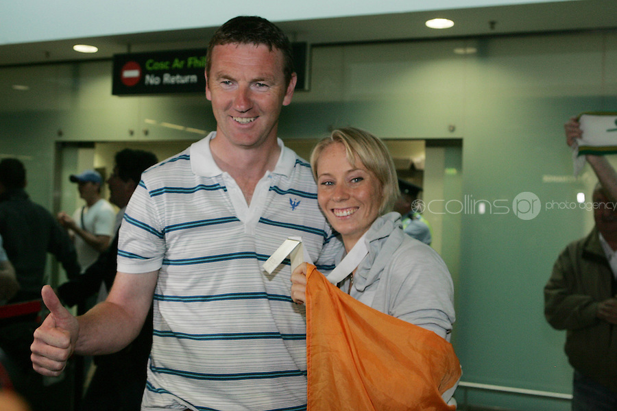 2/8/2010. Derval O'Rourke arrives back into Dublin Aiorport pictrured with her coach Sean Cahill. European silver-medallist Derval O'Rourke has arrived home from Barcelona.O'Rourke finished second in the 100m hurdles on Saturday night to win her second European Athletics Championship silver medal. She was presented with her medal at the Olympic Stadium in Barcelona yesterday evening. Picture James Horan/Collins Photos
