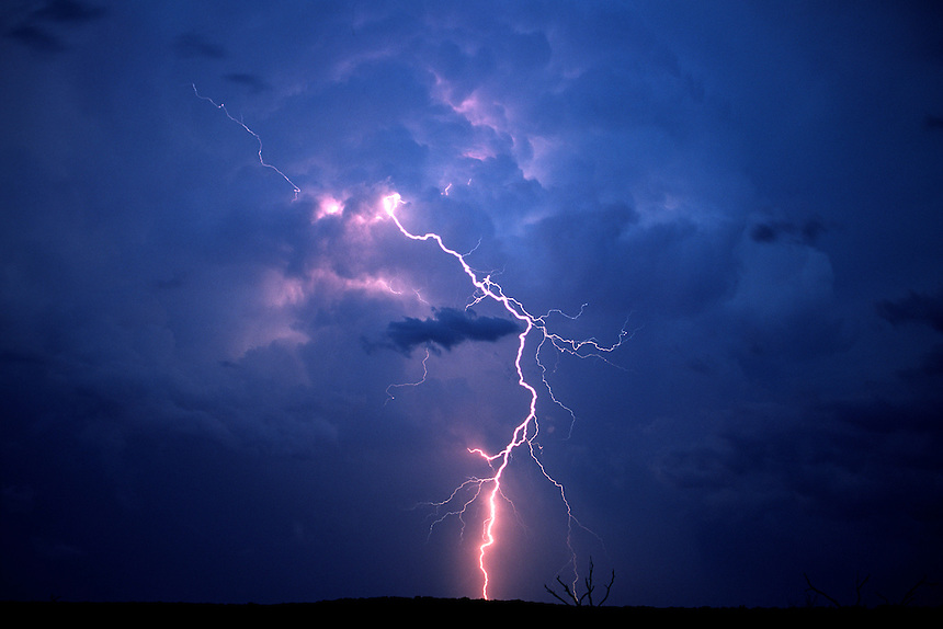 Cloud-to-ground lightning strikes outside of a cumulonimbus (thunderstorm) near Mertzon Texas in June.